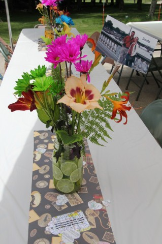 Example of the beautiful flower arrangements--they had lemons and limes in the vases for some summer color and many of the flowers were picked from my mom's gardens. They featured pictures of the fiance and I from around the world.