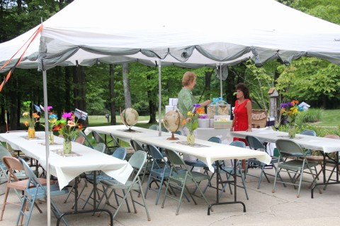 Tent set up--you can see the travel-themed runners and centerpieces.