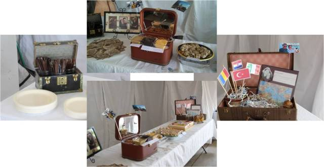The food was adorable--little trunks holding the utensils, pretzels with several dipping sauces and some travel trinkets like an ornament and scrapbook page. Also some of our engagement pictures frames with a map matting.
