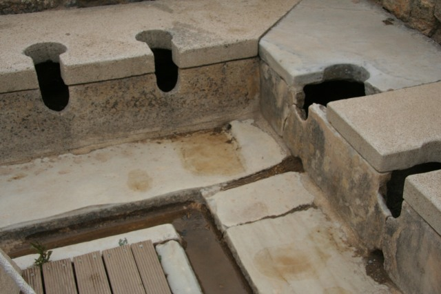 The public toilets where you sat for your business next to your neighbor, were given a stick with a sponge on the end, you dipped the sponge in the trough of water running in front of you, and then you cleaned up before tossing the sponge!